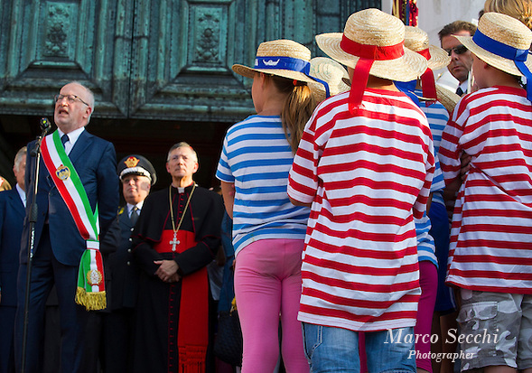 VENICE, ITALY - JULY 20:  Childrens wearing gondoliers shirts listen to the speaches of the Major of Venice and the Patriarch of Venice during the opening of the Redentore Celebrations on July 20, 2013 in Venice, Italy. Redentore is one of the most loved celebrations by Venetians which is in remembrance for the end of the 1577 plague. Highlights of the celebration include the pontoon bridge extending across the Giudecca Canal, gatherings on boats in the St Mark's basin and a spectacular fireworks display.  (Photo by Marco Secchi/Getty Images) (Marco Secchi/Getty Images)