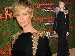 The lady is a vamp! Charlize Theron cuts a willowy figure in gold-fringed black gown at Beverly Hills gala