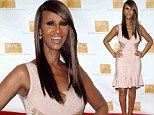 She's still got it! Supermodel Iman, 58, shows off her stunning curves in a figure-hugging pink bandage dress