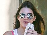 Hot Pink: Kendall Jenner shows off her bright bra underneath her sheer white vest as she enjoys a lunch with friends