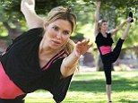 Brandi Glanville shows off her impressive yoga moves during early morning work out in the park