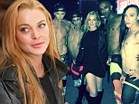 Lindsay Lohan slips into leather once again to cheer on RuPaul's drag queens at LA fashion show