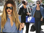 Show of solidarity: The Kardashian-Jenner clan put aside their respective marriage woes to indulge in some retail therapy and a very public lunch at The Ivy