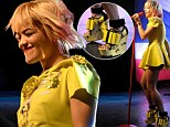 No mellow to this yellow! Rita Ora is queen of the quick change as she rocks out in a pair of massive platform heels...just hours after sporting unflattering dungarees