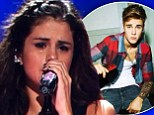 Still in love? Selena Gomez cries onstage TWICE while singing love song... and the tears are thought to be for ex-boyfriend Justin Bieber