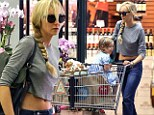 Kimberly Stewart displays her toned stomach in cropped T-shirt as she goes grocery shopping with daughter Delilah
