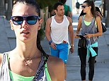Extra boost: Alessandra Ambrosio motivated for her workout by sporting a neon green sports bra as she stepped out in Santa Monica, California on Wednesday
