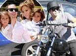 Jennifer Lopez's toy boy Casper Smart puts rumours of a split to rest as he meets the singer at her twin's school on a motorbike