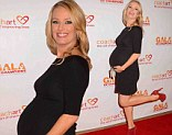 Baby on board: Brooke Anderson showed strong maternity style on Thursday at the CoachArt Gala of Champions in Beverly Hills, California