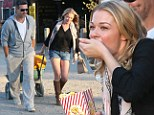 She's got a healthy appetite! LeAnn Rimes scoffs buttery popcorn as she shows off her curvier figure in tiny shorts at the pumpkin patch with Eddie Cibrian