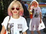 No-one's looking at your hair now! Rita Ora's white tutu-style skirt turns see-through in the sunlight