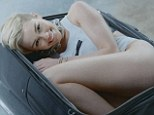 Anything to declare? Miley Cyrus curls up in a suitcase while nearly naked in promo for MTV's European Music Awards