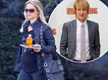 'Love Never Faileth' Owen Wilson¿s personal trainer Caroline Lindqvist displays her blooming baby bump in romantic slogan tee