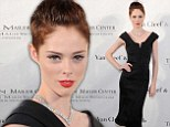 Model Coco Rocha slicks back her short pixie cut to recreate a classic retro style
