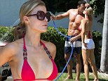 How's that for detailing! Joanna Krupa gives husband Romain Zago a helping hand by washing the car...in a little red bikini