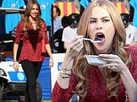 'I love you, cotton candy!' Sofia Vergara cuts a slim figure as she indulges in various sweet confections on set of Modern Family