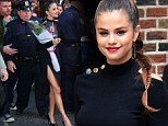 Daring! Selena Gomez, 21, looks all grown up in a sexy black slitted skirt that exposes her toned thighs and a cropped sweater that reveals a fit stomach