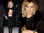 Amanda Holden proves you can never go wrong in black as she wears stylish fur-collared cardigan and barely any make-up for night at the theatre