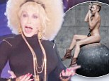 'Hey Miley, I've got your wrecking balls right here!' Dolly Parton dons an afro to rap about her large breasts and even references her controversial goddaughter Miley Cyrus