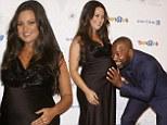 Devious Maids actress Paula Garces displays her burgeoning baby bump at charity gala in New York with Malik Yoba
