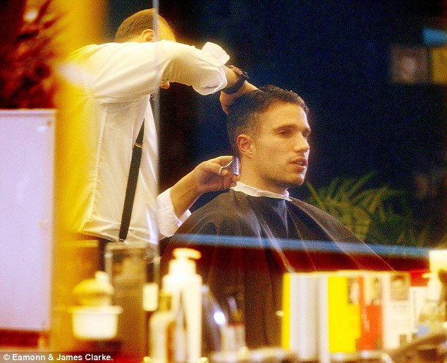 Close shave: Manchester United's Robin van Persie gets his hair cut in Alderley Edge, Cheshire