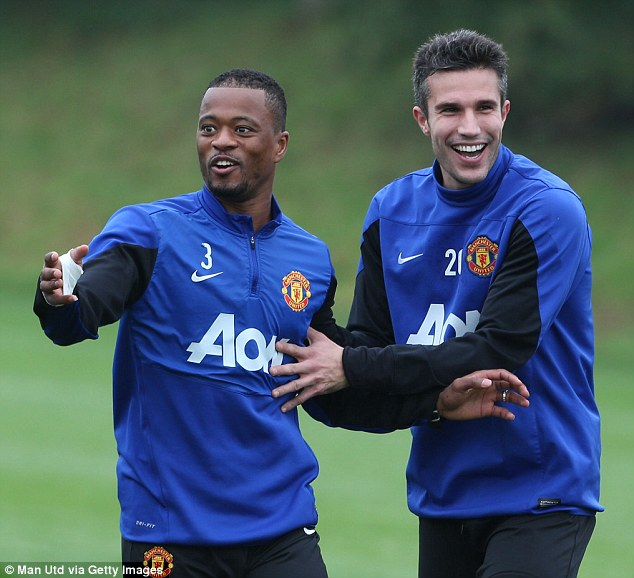 Injury doubt? Van Persie, with Patrice Evra, was all-smiles in training