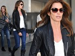 Biker chic! Supermodel Cindy Crawford rocks the leather look in a jacket and boots as she arrives at LAX