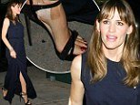 She's plastered! Jennifer Garner's sexy strappy sandal look is ruined by large bandage on her foot (and rogue price tag)