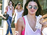 Kendall Jenner shows off her hot pink bra as she steps out in sheer vest for a relaxed lunch with the girls