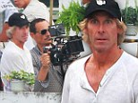 On set: Michael Bay filming the latest Transformers installment in Hong Kong on Thursday, the same day he was attacked by two brothers who demanded an £8,000 payment from him