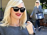 More dainty than usual: Gwen Stefani looked ladylike in a pair of black leggings, snakeskin tunic, grey sweater, and peep-toe booties as she left Planet Nails & Salon in West Hollywood, California on Wednesday