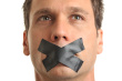 Man with Mouth Taped Shut on White