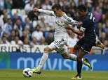 Cameo: Gareth Bale was tripped in the box by Weligton late on as Real Madrid edged out Malaga at the Bernabeu