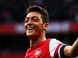 Making the difference: Ozil celebrates doubling Arsenal's advantage