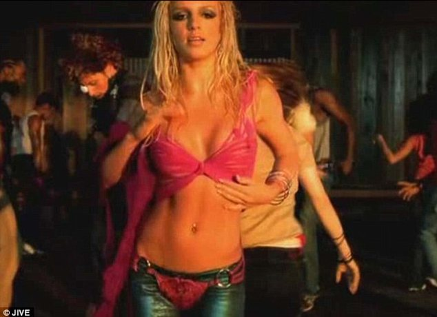 Raunchy: In her 2001 hit Slave 4 U, Britney is seen writhing around in a pair of leather trousers worn with a g-string over the top