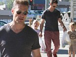 Still turning heads! Jason Priestley looks lean and fit as he takes his children to farmers market