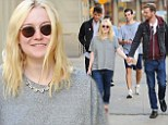 The look of love! Model Jamie Strachan can not help but stare at young girlfriend Dakota Fanning