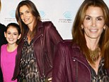 It runs in the family! Cindy Crawford poses with stunning lookalike daughter Kaia at Malibu benefit