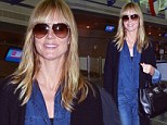 Let's be blunt! Heidi Klum arrives in New York sporting a flattering new haircut but an ill-fitting denim jumpsuit