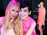 The 30-year-old Les Miserables star wore a coral pink shift dress that landed mid-thigh and was a fitting match to her sixties style pixie cut.