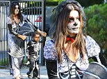 Halloween queen! Doting mother Sandra Bullock shows her ghoulish side as she attends a 'day of the dead' party with son Louis