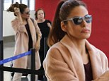 Pretty in pink! Eva Mendes is casual yet stylish as she catches a flight out of LAX