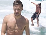 Surfs up: Liam Payne enjoyed a surfing session on the Gold Coast in Australia
