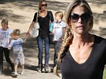 Riding trip: Denise Richards took her daughters Sam and Lola and Charlie Sheen's son Bob horseback riding on Sunday in Burbank, California