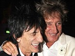 Call off the hugs: Ronnie Wood and Rod Stewart will not be reuniting with the Faces due to Rod's pay demands and Ronnie's tour schedule