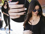 She's nailed it! Kendall Jenner matches monochrome manicure with her footwear as she pumps gas