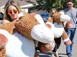 My (big) pony! Kaley Cuoco seems to prefer her snuggly stuffed toy over fiance Ryan Sweeting as they attend a birthday party