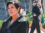 Has she lost her style as well as her marriage? Kris Jenner steps out in manly work boots and a baggy suit in Malibu