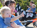Jennifer Garner carves out some Halloween fun at pumpkin patch with her son Samuel as they take a ride in a mechanical cow