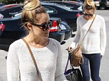 Newly engaged Lauren Conrad enjoys a shopping trip in Hollywood but tries to keep her impressive engagement ring out of sight